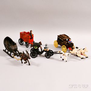 Three Painted Cast Iron Wagons and a Sleigh with Reindeer