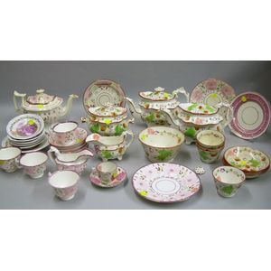 Eighteen Pieces of English Pink Lustre Tableware, a Thirteen-piece Strawberry Decorated Staffordshire Tea Set, ...