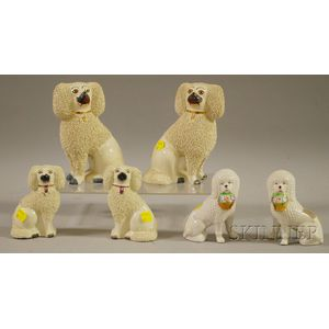 Three Pairs of Staffordshire and Porcelain Seated Spaniel Figures
