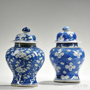 Two Blue and White Covered Jars