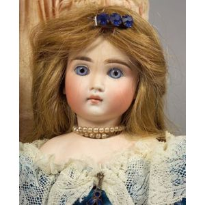 Bisque Swivel Neck Closed Mouth Doll