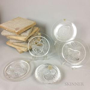 Eight Boxed Lalique Annual Plates and a Fish Plate.     Estimate $300-500