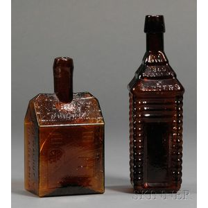 Two Amber Glass Cabin-form Bitters Bottles