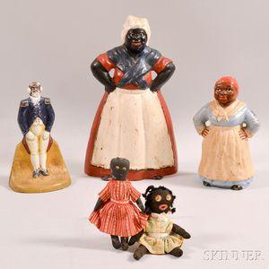 Three Cast Iron Doorstops and Two Black Dolls.     Estimate $20-200