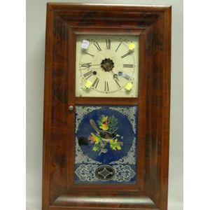 E.N. Welch Mahogany Veneer Ogee and Reverse-Painted Mantel Clock.