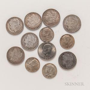 Seven Morgan Dollars, Four Silver-clad Kennedy Half Dollars, and a 1971 Eisenhower Dollar.     Estimate $100-200