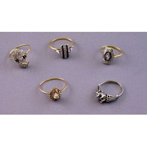 Four Gold, Diamond, and Gem-set Rings and a Platinum Ring Mount