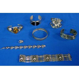 Seven Silver Bracelets