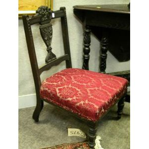 Pair of Renaissance Revival Upholstered Carved Walnut Slipper Chairs.
