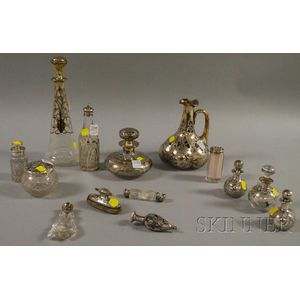 Approximately Thirteen Silver Overlay Decanters, Vanity, and Perfume/Scent Bottles